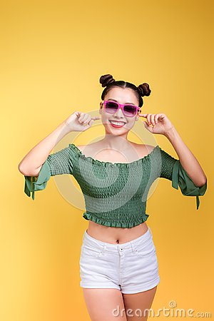Free Stylish Beautiful Young Woman In Sunglasses Against Yellow Backg Stock Photo - 116997860