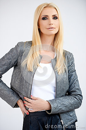 Stylish blond woman in a leather jacket