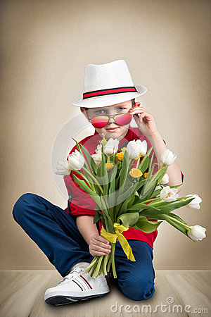 Free Stylish Boy In A Hat Holding A Bouquet Of Spring Tulips.Children`s Fashion.Women`s Day,mother`s Day. Stock Photography - 94305872