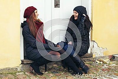Stylish Brunettes Sharing a Good Laugh