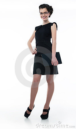 Stylish business woman in black dress with laptop