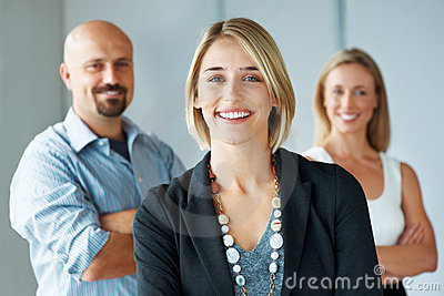 Stylish business woman with team at the back