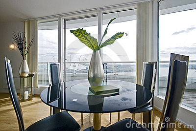 Stylish dining area with round glass top table