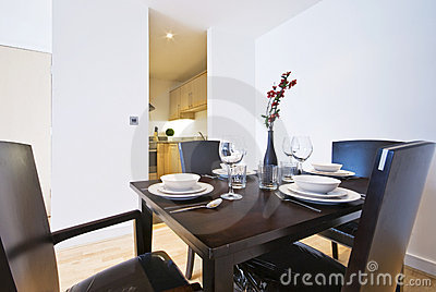 Stylish dining area with set up for four
