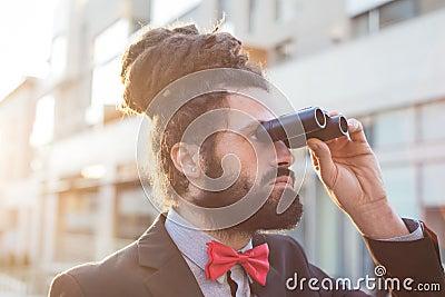 Stylish elegant dreadlocks businessman binoculars