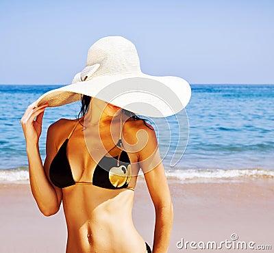 Stylish girl on the beach
