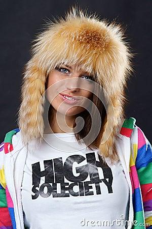 Stylish girl in fur hat