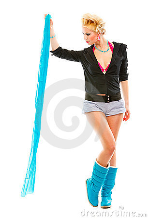 Stylish girl looking on blue scarf in her hand