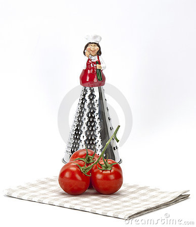 Stylish grater and tomatoes