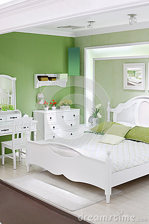 Stylish green bedroom with double bed