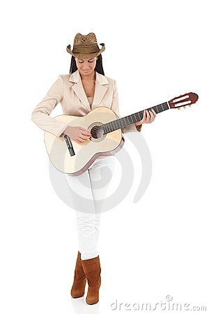 Stylish guitar player enjoying music