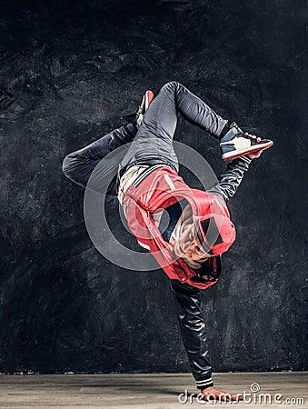 Free Stylish Guy Performs Breakdance Acrobatic Elements. Royalty Free Stock Image - 142451366