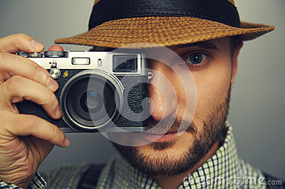 Stylish handsome man with camera