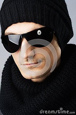 Stylish handsome man in dark sunglasses