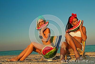 Stylish ladies at sea with watermelon