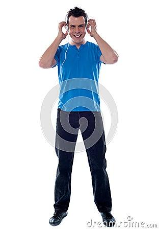 Stylish man enjoying music on headphones
