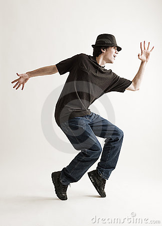 Stylish man in hat dancing