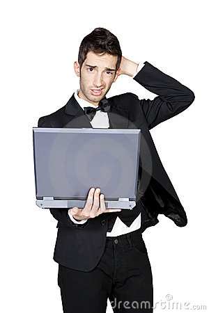 Stylish man looking confused and holding laptop