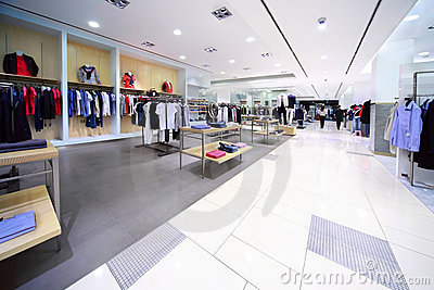 Stylish masculine clothes are for sale in shop