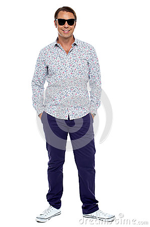 Stylish middle aged man posing in casuals