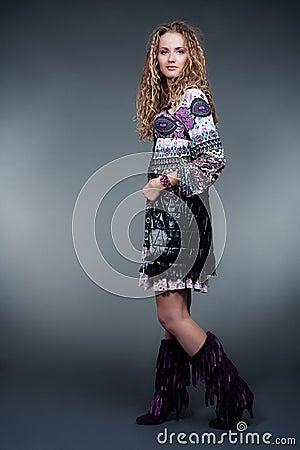 Stylish model in motley dress
