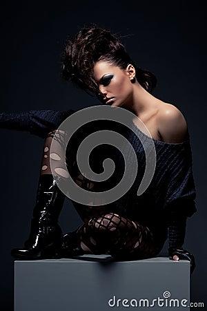 Stylish model with naked shoulder