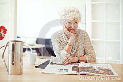 Stylish Old Lady at Home Reading