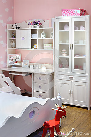 Stylish pink bedroom for girl with bed