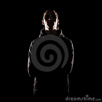 Stylish portrait of man over dark background