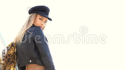 Stylish portrait model of outdoor. Fashion young woman posing outside in a city street. Stylish portrait model of outdoor. Fashion young woman posing outside in stock footage