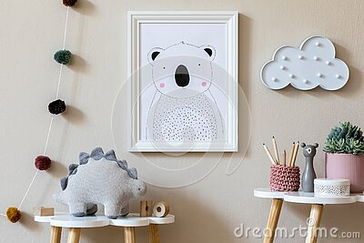 Playroom for kids with cute toys and mockup poster frame in Scandinavian style. Stock Photo
