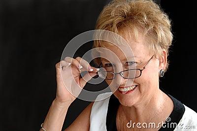 Stylish senior wearing glasses