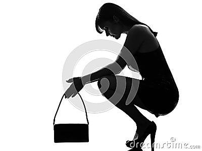 Stylish silhouette woman crouching thinkig despair