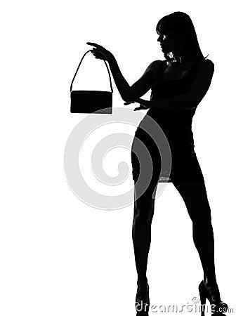 Stylish silhouette woman holding purse w