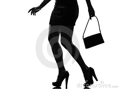Stylish silhouette woman legs walking