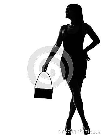 Stylish silhouette woman waiting holding purse