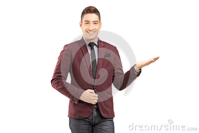 A stylish smiling male gesturing with hi hand
