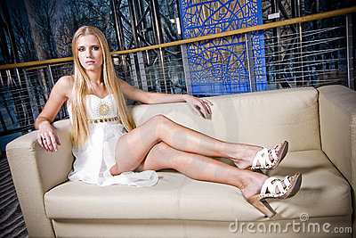Stylish teenage girl on sofa