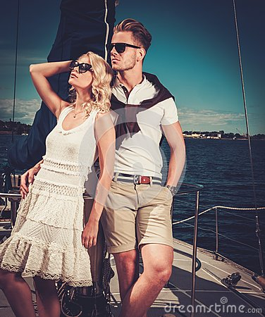 Stylish wealthy couple on yacht