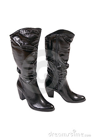 Stylish winter boots for women on a white.