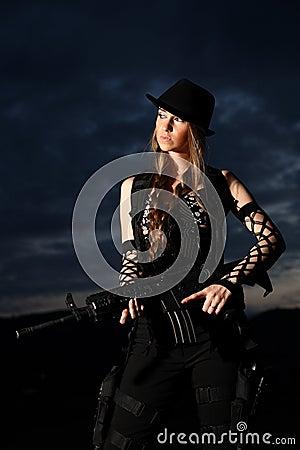 Stylish woman with assault rifle