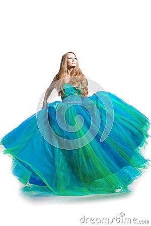 Stylish woman in a blue dress