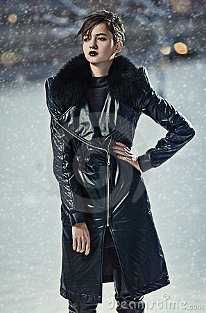 Stylish woman in leather coat