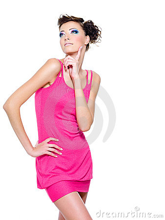 Stylish woman posing in pink dress