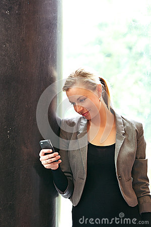 Stylish woman reading text messages