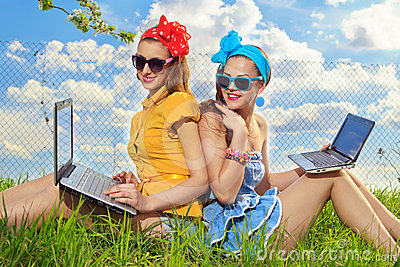 Stylish woman using laptops