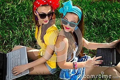 Stylish woman using laptops