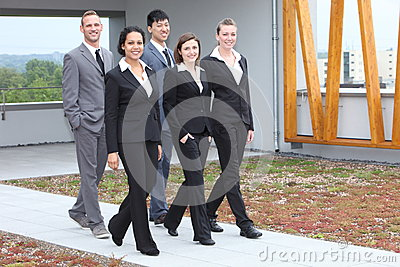 Stylish young business team walking together