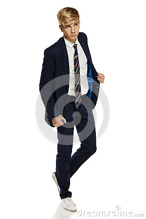 Stylish young man in suit walking