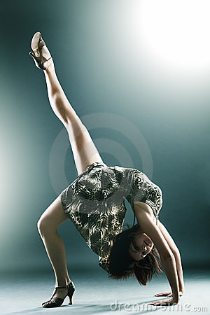 Stylish and young modern style dancer stretching